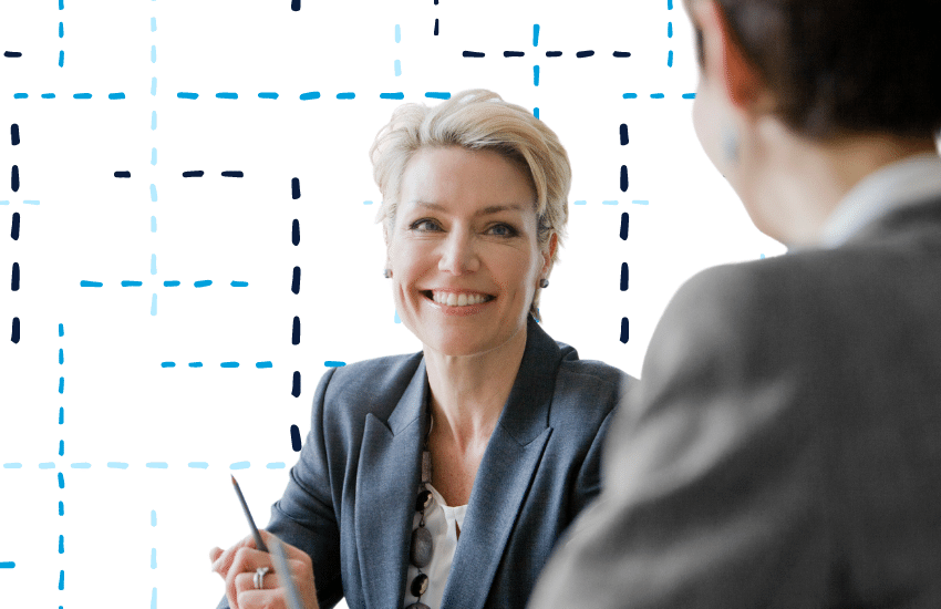 Woman smiling during business meeting